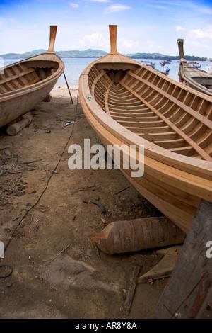 New wooden fishing boats being built at Bang Tao Beach on Phuket Island, Thailand, Asia - Stock Photo