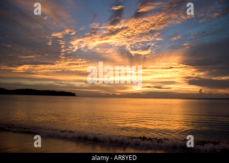 A beautiful sunset and reflection over the Andaman Sea on the coast of Phuket, Thailand, Asia - Stock Photo