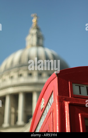 Old Red Phone Box, St Pauls Cathedral Blurred Dome in Background - Stock Photo
