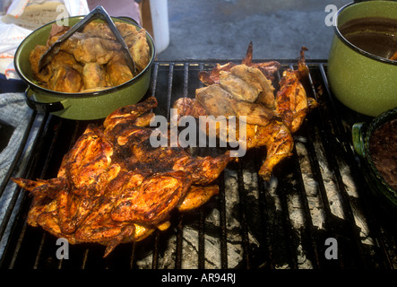 food vendor, seller, selling, grilled chicken, grilling chicken, open-air market, village, Tlacolula de Matamoros, - Stock Photo