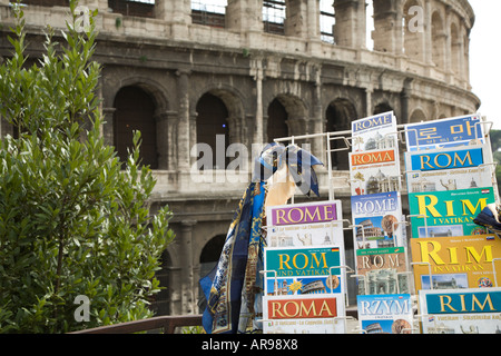 Guide books for sale at the Colosseum in Rome Italy - Stock Photo