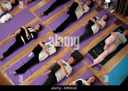 shot of yoga class with women lying on floor yoga class