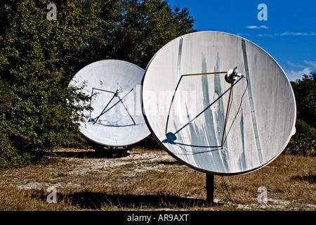 Two satellite dish antennas pointing towards the sky, Jekyll Island, Georgia, USA - Stock Photo
