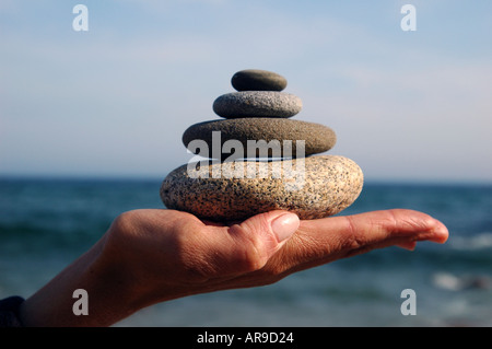 Relax yoga Hand with pile of rocks design and neatness - Stock Photo
