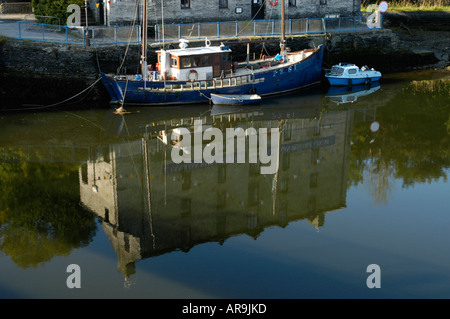 Heritage Centre reflected in the waters of the River Teifi at Cardigan - Stock Photo