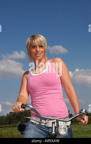 junge Frau blond mit Fahrrad sommer - young blonde woman with bike summer - Stock Photo