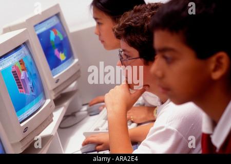 Multiracial junior middle school students in school computer class - Stock Photo