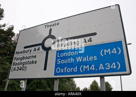 Navigational road sign on A4 at Theale below Junction 12 of the M4 motorway Reading Berkshire - Stock Photo