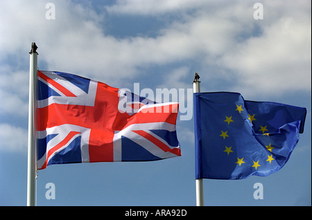 A United Kingdom flag flying next to a European Union flag - Stock Photo