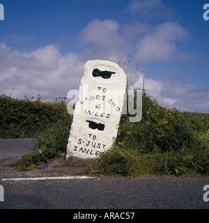 A stone milestone by the roadside at Penwith Cornwall indicating the distance to Lands End and St Just