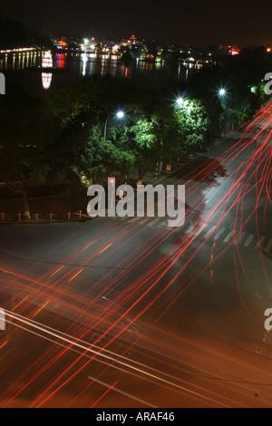 Night traffic by Hoan Kiem Lake Hanoi Vietnam - Stock Photo