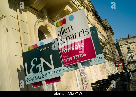'For Sale' signs outside properties - Stock Photo