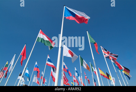 international flags flying against a blue sky - Stock Photo