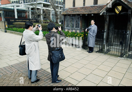 Japanese tourists outside William Shakespeare s birthplace in Stratford on Avon in Warwickshire UK - Stock Photo