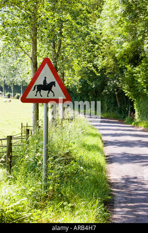 Roadside sign warning of accompanied horses or ponies Dorset UK - Stock Photo