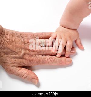 Baby's Hand Touching Woman's Hand Stock Photo