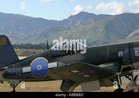 Goodyear Corsair FG 1D whispering death fighter bomber and Mustangs Killtyhawks in distance - Stock Photo
