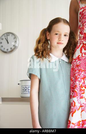 Portrait of Daughter Standing Beside Mother - Stock Photo