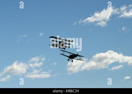 Brisitsh Sopwith Camel Biplane and German Fokker Dr 1 Triplane WWI fighter planes - Stock Photo