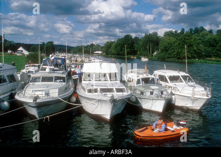A gathering for Broom motor cruiser enthusiasts on the River Thames at Henley in Oxfordshire England UK - Stock Photo