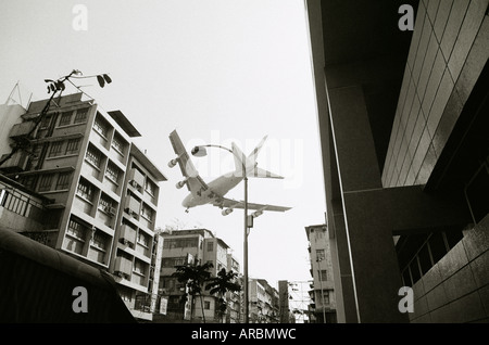 Aeroplane arriving at the old Kai Tak airport in Kowloon in Hong Kong in China in Far East Southeast Asia. Transport - Stock Photo