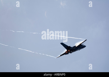 RAF Tornado GR4 617 Squadron afterburner low level pass condensation forming on wings - Stock Photo