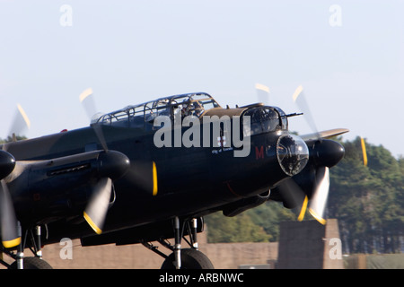 Battle of Britain Memorial Flight RAF Lancaster Bomber on runway - Stock Photo