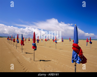 Colourful umbrellas on the beach, Deauville, Normandy, France - Stock Photo