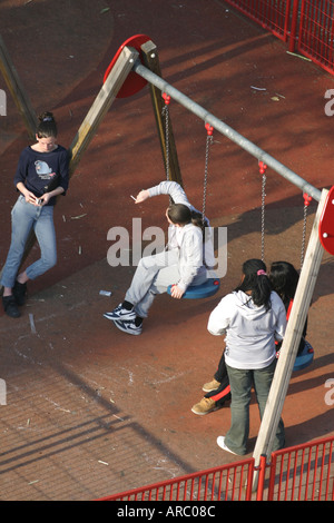 Teenagers hanging around in a playground in south London, England UK - Stock Photo