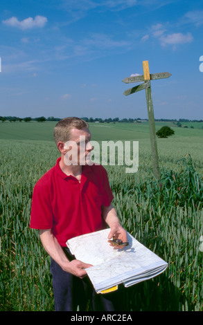 Hike using map and compass to find his location near the villages of Barwick in Elmet and Scholes, Yorkshire United - Stock Photo