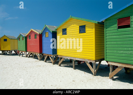 Brightly painted beach bathing huts at False Bay, Muizenburg, Cape Town, South Africa - Stock Photo