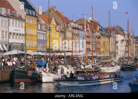 Restaurants and bars in the Nyhavn waterfront area, Copenhagen, Denmark, Scandinavia, Europe - Stock Photo