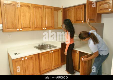 Miami Beach Florida women inspect new kitchen rental housing apartment - Stock Photo
