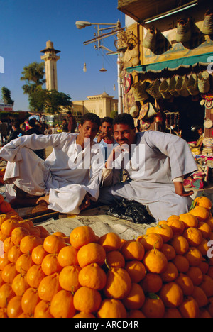 Market traders by their orange stall, Luxor, Egypt, North Africa - Stock Photo