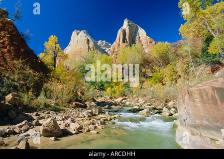 Peaks of Abraham and Isaac tower above the Virgin River, Court of the Patriarchs, Zion National Park, Utah, USA - Stock Photo