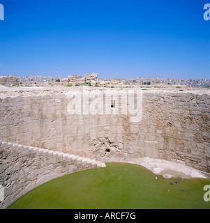 Jebel al-Qal'a (Citadel). Cistern, dug 5m deep by 16m across to supply water to the Umayyad palace, Amman, Jordan, - Stock Photo
