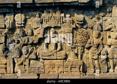 Relief carvings on frieze on outside wall of the Buddhist temple, Borobodur (Borobudur), Java, Indonesia - Stock Photo