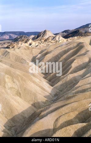 Zabriskie Point CA Death Valley National Park desert wilderness arid mountains dry barren landform - Stock Photo