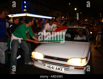 Italian fan plays matador with car in Shaftesbury Avenue after winning 2006 World Cup vs France, Soho, London - Stock Photo