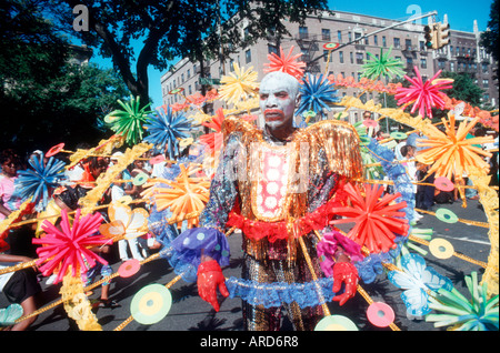 Festively costumed dancers perform in the annual West Indian American Carnival Parade in Brooklyn - Stock Photo