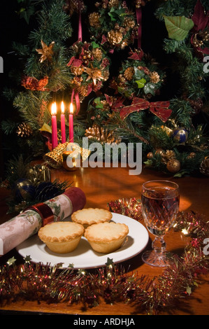 Santa's Treat for supper: Shop bought mince pies with a glass of SHERRY in a Waterford cut glass - Stock Photo