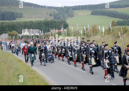 Lonach Highlanders Marching down the Glen to the games field in Strathdon. Aberdeenshire. Scotland.  XPE 3633-352 - Stock Photo