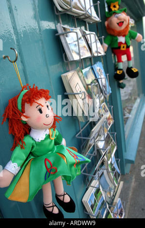 Irish holiday souvenirs hanging up outside shop in village of Avoca, County Wicklow, Republic of Ireland - Stock Photo