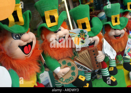Four Leprechaun cuddly toys in shop window in Wexford town, County Wexford, Ireland - Stock Photo