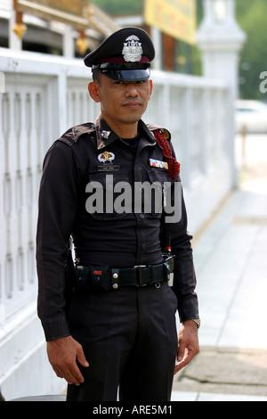Thailand Bangkok Policeman on duty - Stock Photo