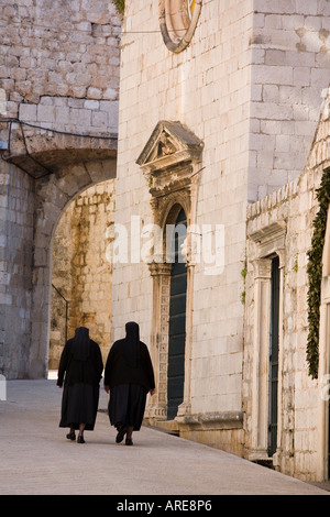 Two Nuns Walk Together in the Streets of Dubrovnik Croatia - Stock Photo