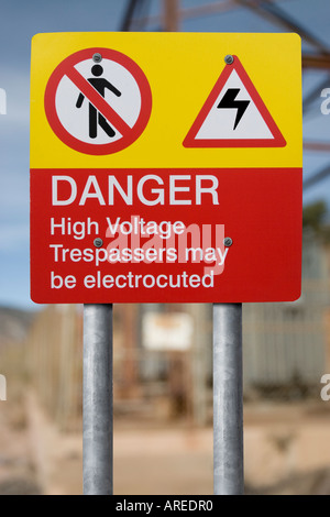 DANGER High Voltage Trespassers may be electrocuted warning sign - Stock Photo