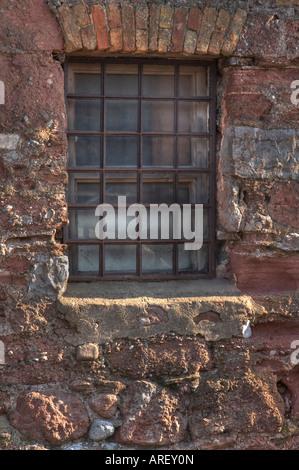 Window in old wall, Teignmouth, Devon - Stock Photo