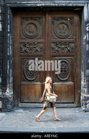 Large carved wooden door in the Gothic Cathedral of St Peter in the ...