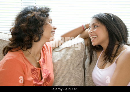 mother and daughter chatting - Stock Photo